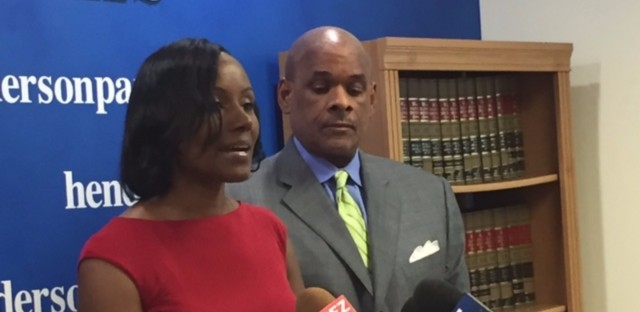 Rhonda Crawford (left) stands next to her attorney Victor Hendreson. She says she will continue to run in the upcoming judicial election.