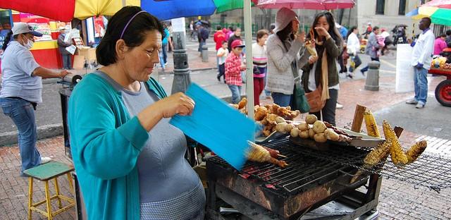Fanning charcoal grill with mazorca near Plaza de Bolívar in Bogotá, Colombia