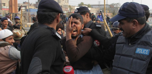 Police arrest supporters of a Pakistani religious group trying to rally in support of blasphemy laws, on the anniversary of the death of Salman Taseer, Pakistani governor of Pakistan's Punjab province, who was killed by his bodyguard in 2011 for opposing the country's harsh blasphemy laws, in Lahore, Pakistan on Jan. 4, 2017.
