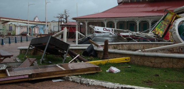 Debris litters a street on the French island of St. Martin on Tuesday as residents prepare for the arrival of Hurricane Maria.