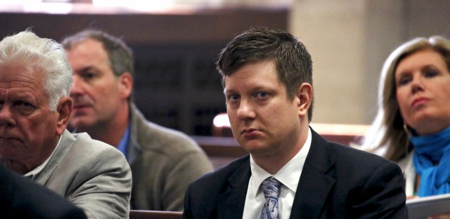 Chicago police officer Jason Van Dyke, charged with first-degree murder in the October 2014 shooting death of a black teenager, sits in court for a hearing in his case in Chicago. Cook