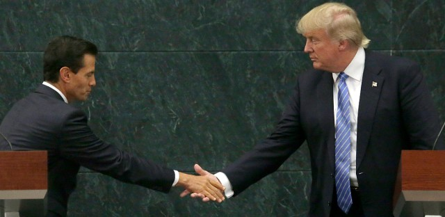 Mexico's President Enrique Pena Nieto and Republican presidential nominee Donald Trump shake hands after a joint statement in Mexico City on Aug. 31, 2016. Trump is calling his surprise visit to Mexico City a 'great honor.' The Republican presidential nominee said after meeting with Pena Nieto that the pair had a substantive, direct and constructive exchange of ideas.
