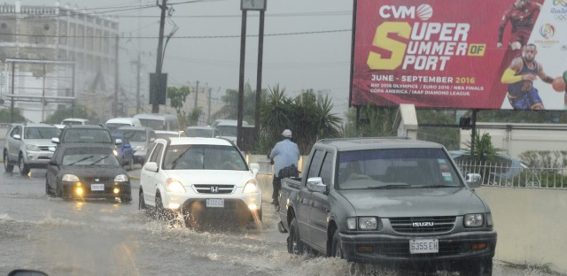 Heavy rain hits downtown Kingston, Jamaica, on Sunday ahead of Hurricane Matthew's expected arrival.