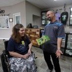 In this Tuesday, Oct. 20, 2015 photo, Shamay Flaharty, of Lewiston, Ill., who has multiple sclerosis and is hoping cannabis will help ease her pain and headaches, meets with Eric Sweatt, partner and manager of Salveo Health and Wellness, a licensed medical cannabis dispensary, in Canton, Ill. (AP Photo/Seth Perlman)