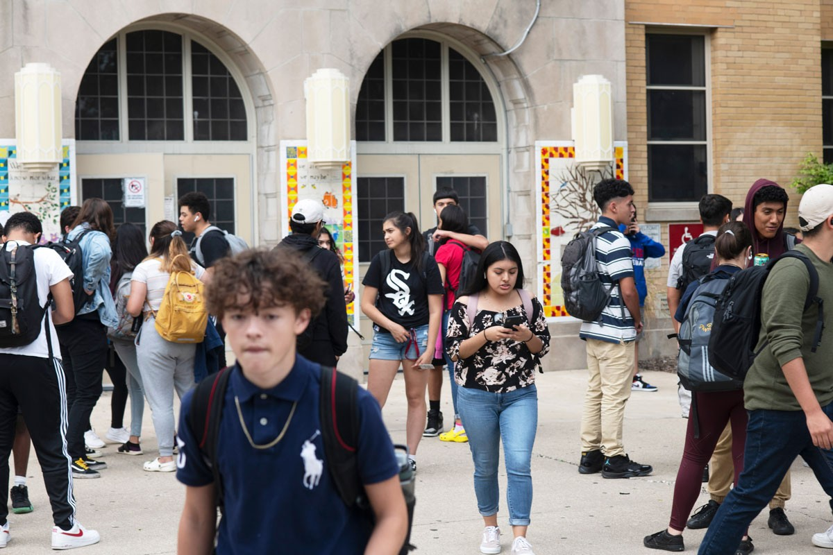 Students gather outside of Hancock College Prep after a day at school.