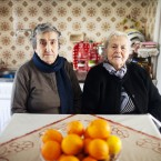 "The mothers of Militsa Kamvysi, 83, (left) and Maritsa Mavrapidou, 85, arrived on the Greek island of Lesbos nearly a century ago as refugees from what was then the Ottoman Empire (now Turkey). ""We welcomed refugees because we're descended from refugees, too,"" Mavrapidou says."