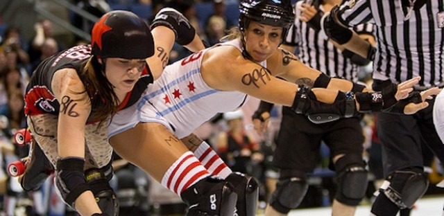 WCR's Yvette Yermaker (right) booty-blocks a Kansas City jammer at the 2011 Derby National Championships in Denver, Colo.