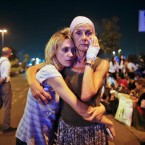 Passengers embrace each other as they wait outside Istanbul's Ataturk airport, early Wednesday morning following their evacuation after a blast. Suspected Islamic State group extremists have hit the international terminal of Istanbul's Ataturk airport, killing dozens of people and wounding many others, Turkish officials said Tuesday. Turkish authorities have banned distribution of images relating to the Ataturk airport attack within Turkey.