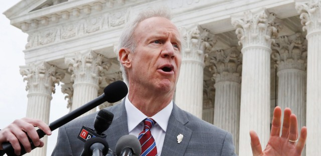 In this Monday, Feb. 26, 2017, file photo, Illinois Governor Bruce Rauner speaks to the media outside the Supreme Court, in Washington. Gov. Rauner plans to veto legislation that would require gun retailers to be licensed by the state of Illinois. Rauner spokeswoman Rachel Bold says the governor will veto the measure Tuesday, March 13, 2018, a week before the state's primary election in which the Republican faces a challenge from state Rep. Jeanne Ives. Chicago Mayor Rahm Emanuel backed the measure. He says Rauner is putting the primary election ahead of his responsibility for public safety. (AP Photo/Jacquelyn Martin, File)