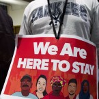 Immigrant rights advocates protest then-President-elect Donald Trump's immigration policies last month. A new study shows that more than 60 percent of the people in this country illegally are concentrated in 20 metro areas.