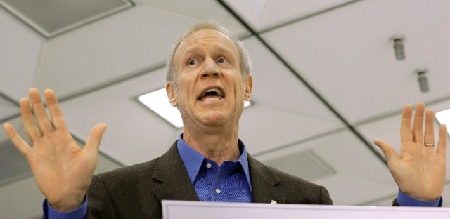 Illinois Gov. Bruce Rauner speaks to reporters on the Wednesday, March 30, 2016, at the State of Illinois Central Computing Facility in Springfield, Ill. Rauner accused Illinois Speaker of the House Michael Madigan, D-Chicago, and fellow Democrats of playing games by purposefully stalling on talks so they can make a case for a huge tax hike.