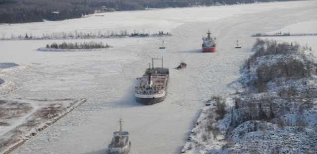 U.S. Coast Guard Cutters break ice in the lower end of the Rock Cut in the St. Mary's River in Michigan.