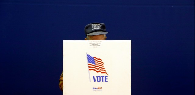 A voter fills out a ballot at a polling place at Lake Shore Elementary School, Tuesday, Nov. 6, 2018, in Pasadena, Md.