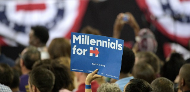 A Hillary Clinton supporter holds a sign in the crowd as President Barack Obama addresses a crowd at a Hillary for America campaign event in Orlando, Fla., on Oct. 28, 2016. After working on Clinton's campaign, Northwestern alumna Amanda Litman co-founded Run for Something to recruit and support young, diverse progressives running for state and local office.