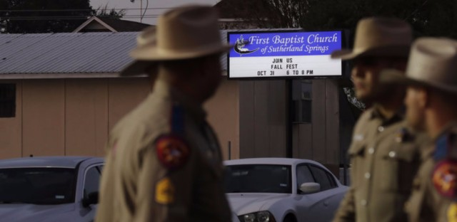 Law enforcement officials gather Monday at the scene of a deadly shooting the previous day at the First Baptist Church of Sutherland Springs in Texas. (Eric Gay/AP)