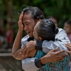 Former slave fisherman Myint Naing, left and his mother Khin Than, cry as they are reunited after 22 years at their village in Mon State, Myanmar, on May 16, 2015.