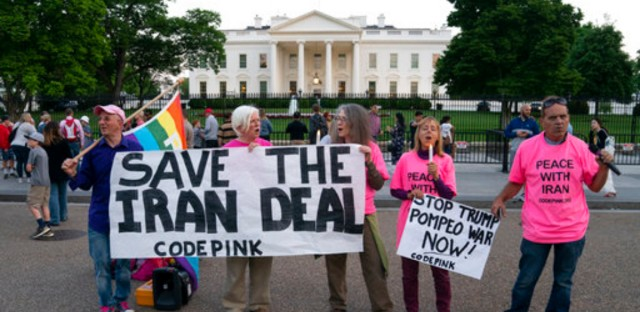 Members of Code Pink, from left, Sergei Kostin, Paki Wieland, Leah Brown, Medea Benjamin and Tighe Barry rally in support of Iran's nuclear deal with world powers in front of the White House in Washington, Monday, May 7, 2018. President Donald Trump is set to reveal his decision on whether to keep the U.S. in the Iran deal on Tuesday, a move that could determine the fate of 2015 agreement that froze Iran's nuclear program.