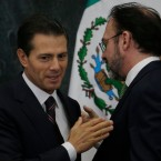 Mexico's President Enrique Pena Nieto, left, and Mexico's new Foreign Relations Secretary Luis Videgaray chat at the Los Pinos presidential residence in Mexico City, Wednesday, Jan. 4, 2017. Mexico's president has brought back Videgaray, a close adviser who resigned after arranging a meeting between Pena Nieto and then-presidential candidate Donald J. Trump.