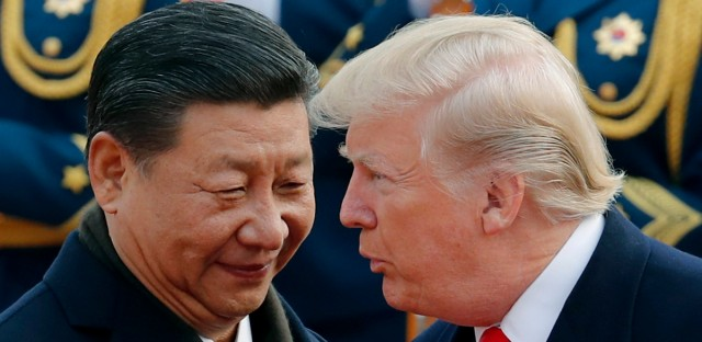 In this Nov. 9, 2017, file photo, U.S. President Donald Trump, right, chats with Chinese President Xi Jinping during a welcome ceremony at the Great Hall of the People in Beijing. The United States and China are scheduled to resume talks at the G-20 Summit in Japan from June 28 to 29, 2019.