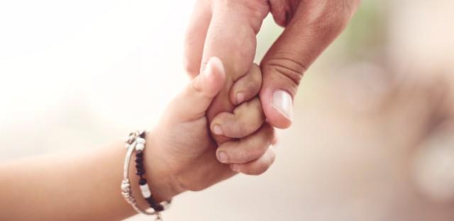 hand holding child