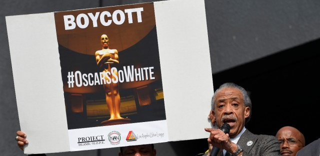 Rev. Al Sharpton, right, and activist Najee Ali lead a rally prior to the Academy Awards ceremony, Sunday, Feb. 28, 2016, in the Hollywood section of Los Angeles in support of the nationwide tv tune-out protesting the lack of diversity in Hollywood. (AP Photo/Mark J. Terrill)