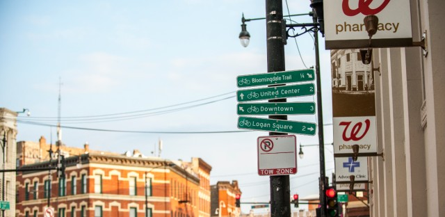 A sign points toward Logan Square, where recent census data shows about 46 percent of residents are white and 44 percent are Latino.