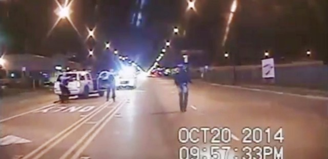 In this frame from dash-cam video provided by the Chicago Police Department, Laquan McDonald, right, walks down the street moments before being fatally shot by CPD officer Jason Van Dyke sixteen times in Chicago.