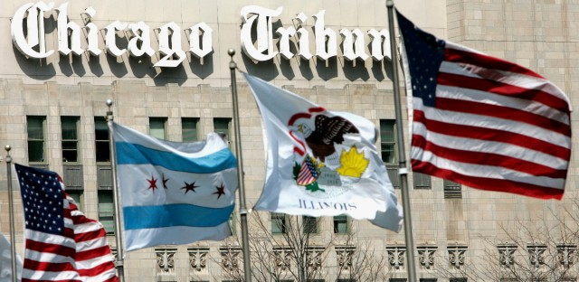 Flags wave near the Chicago Tribune Tower in downtown Chicago.