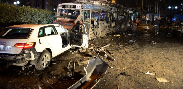Damaged vehicles are seen at the scene of an explosion in Ankara, Turkey, Sunday, March 13, 2016. The explosion is believed to have been caused by a car bomb that went off close to bus stops. News reports say the large explosion in the capital has caused several casualties. (Selahattin Sonmez/Hurriyet Daily via AP)