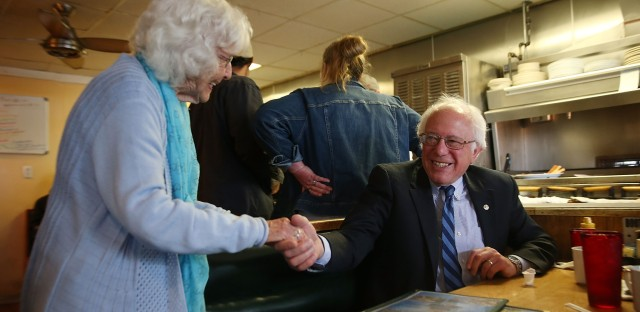 Madonna Rea shakes hands with Democratic presidential candidate Bernie Sanders as he has breakfast at Peppy Grill on Tuesday in Indianapolis.