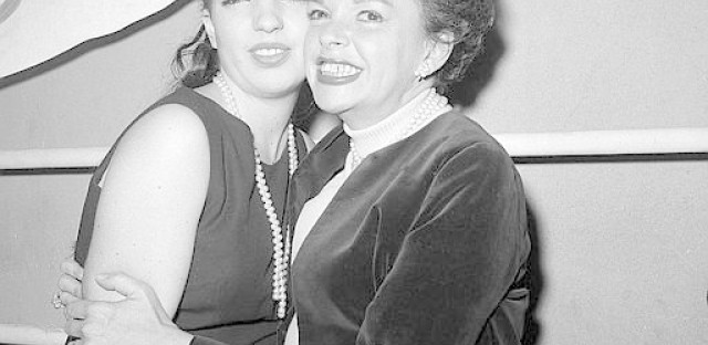 """Judy Garland hugs her 17-year-old daughter Liza Minnelli after watching Liza star in the Off-Broadway revival of the 1941 musical """"Best Foot Forward"""" in 1963."""