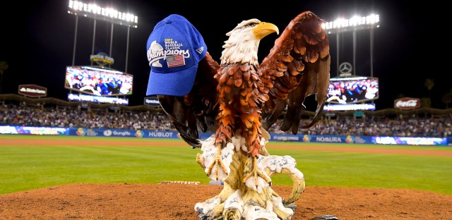 United States eagle statue mascot stands on the mound in celebration, a blue cap jauntily hanging from one of its large wings, after their 8-0 win over Puerto Rico in the final of the World Baseball Classic in Los Angeles, Wednesday, March 22, 2017.