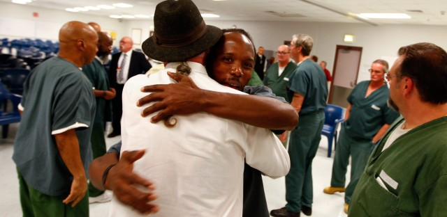 Inmate Christopher Penley hugs Wells goodbye at the end of the session.