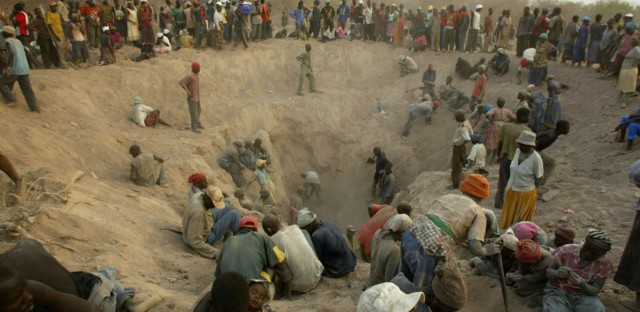 "This Nov. 1, 2006 file photo shows miners digging for diamonds in Marange, eastern Zimbabwe. The international body charged with monitoring and preventing the sale of blood diamonds on Friday made it easier for Zimbabwe to export diamonds that are certified as conflict free. At the same time, the group was unable to reach agreement on a new definition for ""conflict diamonds"" that would have expanded its current mandate. Meeting in Washington, the members of the so-called ""Kimberley Process"" let lapse a requirement that mining at Zimbabwe's notorious Marange diamond fields be monitored. Allegations of violence and worker mistreatment at Marange led the group to first ban sales and then impose monitoring on operations at the fields last year to ensure that no abuses were taking place."