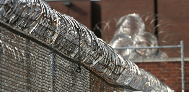 Razor wire rings the Cook County Jail on Tuesday, Feb. 14, 2006, in Chicago.