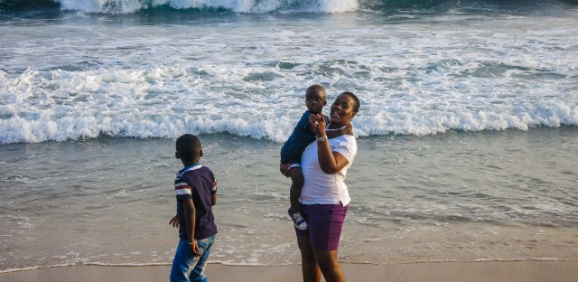 Safiatou Sylla, a mother of three, visits Grand Bassam with her family to show she's not afraid of terrorists. On March 13, al-Qaida gunmen killed some 19 people at the beachfront town.
