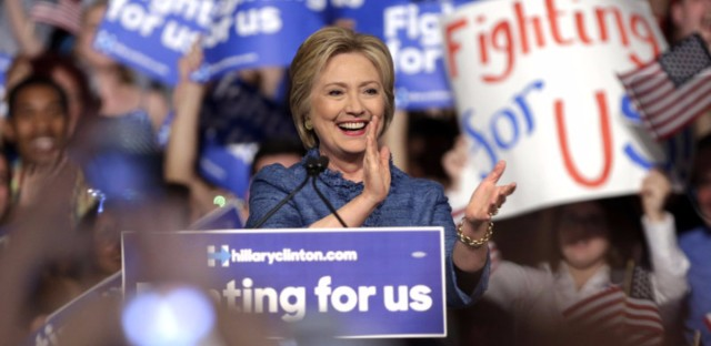 Hillary Clinton applauds during her victory speech in Florida Tuesday.