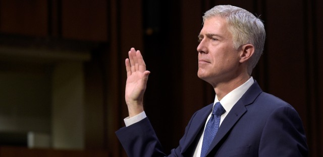 A then Supreme Court Justice nominee Neil Gorsuch is sworn in on Capitol Hill in Washington, Monday, March 20, 2017, during his confirmation hearing before the Supreme Court Justice Neil GorsuchJudiciary Committee.