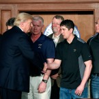 President Donald Trump shakes hands with employees from Rosebud Mining Co