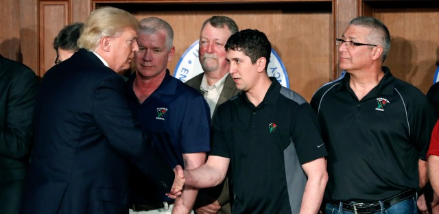 President Donald Trump shakes hands with employees from Rosebud Mining Co. before signing an Energy Independence Executive Order on March 28, 2017. Trump took steps on coal regulation and broader energy policy.  (AP Photo/Pablo Martinez Monsivais, File)