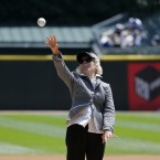 Illinois Supreme Court Justice Anne Burke throws out a ceremonial first pitch before a baseball game between the Chicago White Sox and the Kansas City Royals Wednesday, July 23, 2014, in Chicago.