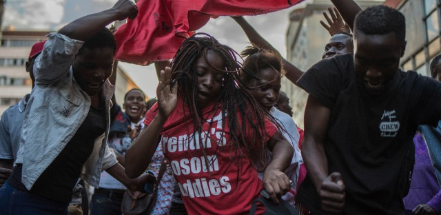 Main opposition Movement for Democratic Change (MDC) supporters celebrate outside their headquarters in Harare, Tuesday, July 31, 2018, believing they have won the elections that took place Monday. Zimbabweans hope the election will help to lift their country out of economic and political stagnation.