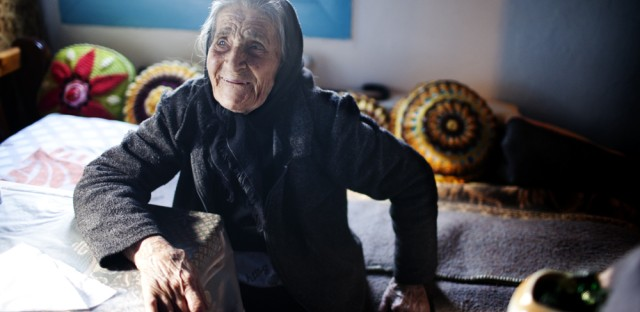 "Efstratia Mavrapidou, 89, at her home in the village of Skala Sikaminias, Lesbos. ""When my mother arrived here in 1922, there were five impoverished farmers here,"" she says. ""She and her babies slept in sheds where olives were stored."""