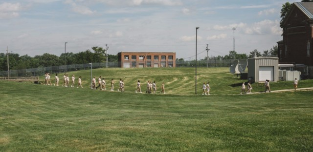 Women walk through the courtyard to lunch at the Indiana Women's Prison in Indianapolis on May 17, 2017.