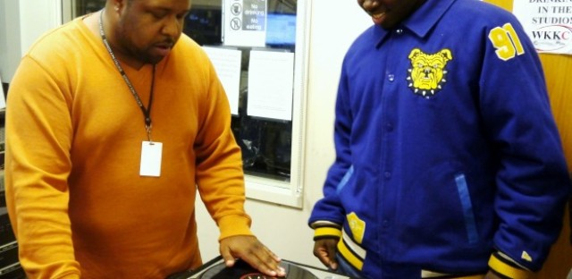 Jamar Houston of WKKC teaches Jermaine Robinson how to DJ.