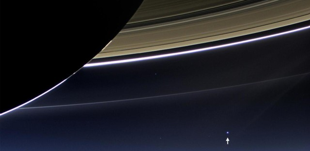 A rare image shows Earth, a billion miles away, behind Saturn's rings. Returned in July 2013.
