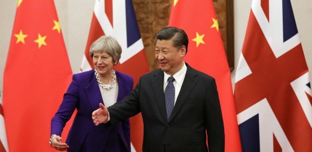Chinese President Xi Jinping, right, and British Prime Minister Theresa May gesture ahead a meeting at the Diaoyutai State Guesthouse in Beijing, Thursday, Feb. 1, 2018.