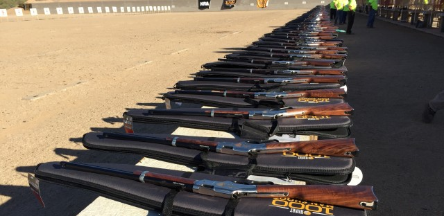 Range safety officers look over a line of 1,000 Henry Golden Boy Silver rifles before an NRA-sponsored event in Phoenix. Each participant took two shots, celebrating the presidential election results.