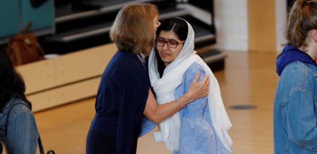 Malala Yousafzai is congratulated after collecting her 'A' level exam results at Edgbaston High School for Girls in Birmingham, England.