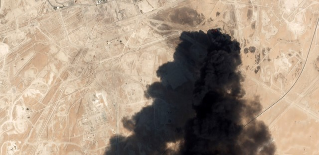 This Saturday, Sept. 14, 2019, satellite image from Planet Labs Inc. shows thick black smoke rising from Saudi Aramco's Abqaiq oil processing facility in Buqyaq, Saudi Arabia. Yemen's Houthi rebels launched drone attacks on the world's largest oil processing facility in Saudi Arabia and a major oil field Saturday, sparking huge fires and halting about half of the supplies from the world's largest exporter of oil.